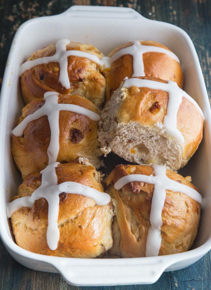 hot cross buns in a white pan