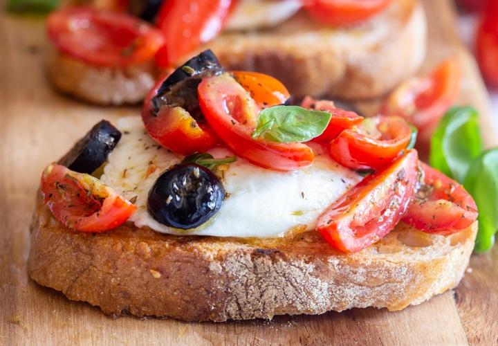 upclose slice of caprese bruschetta
