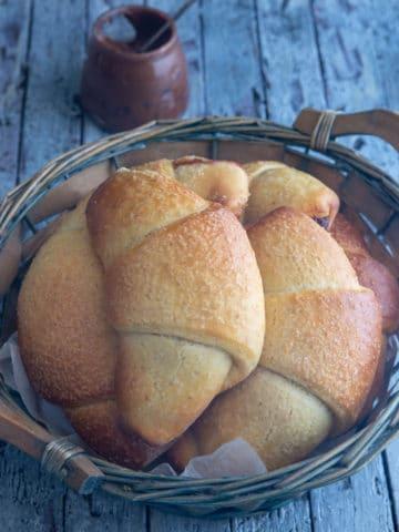 sourdough crescents in a blue basket.