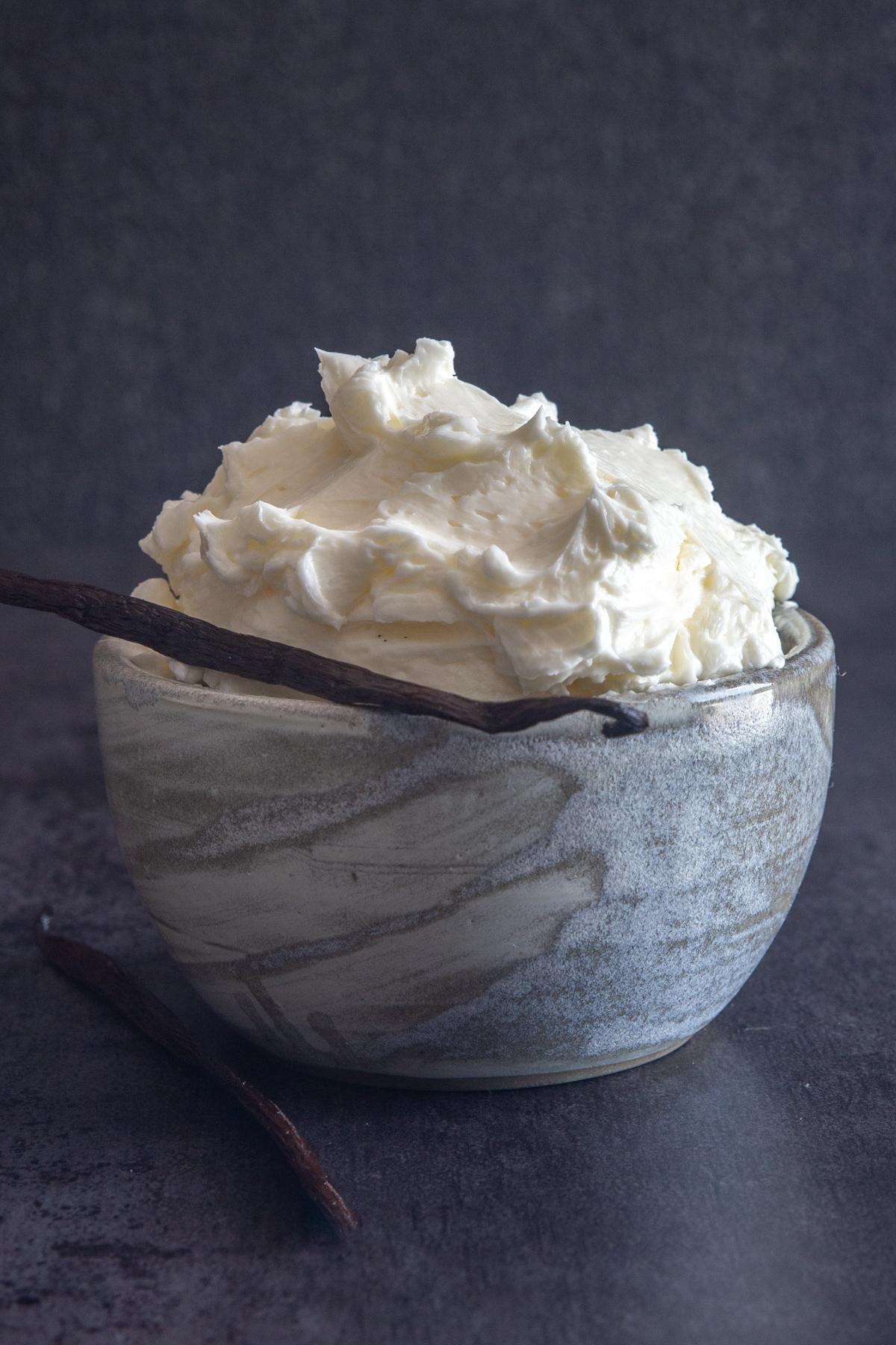 Swiss meringue buttercream in a blue bowl.