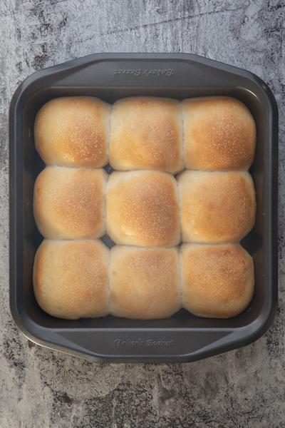 Baked rolls in a black pan.